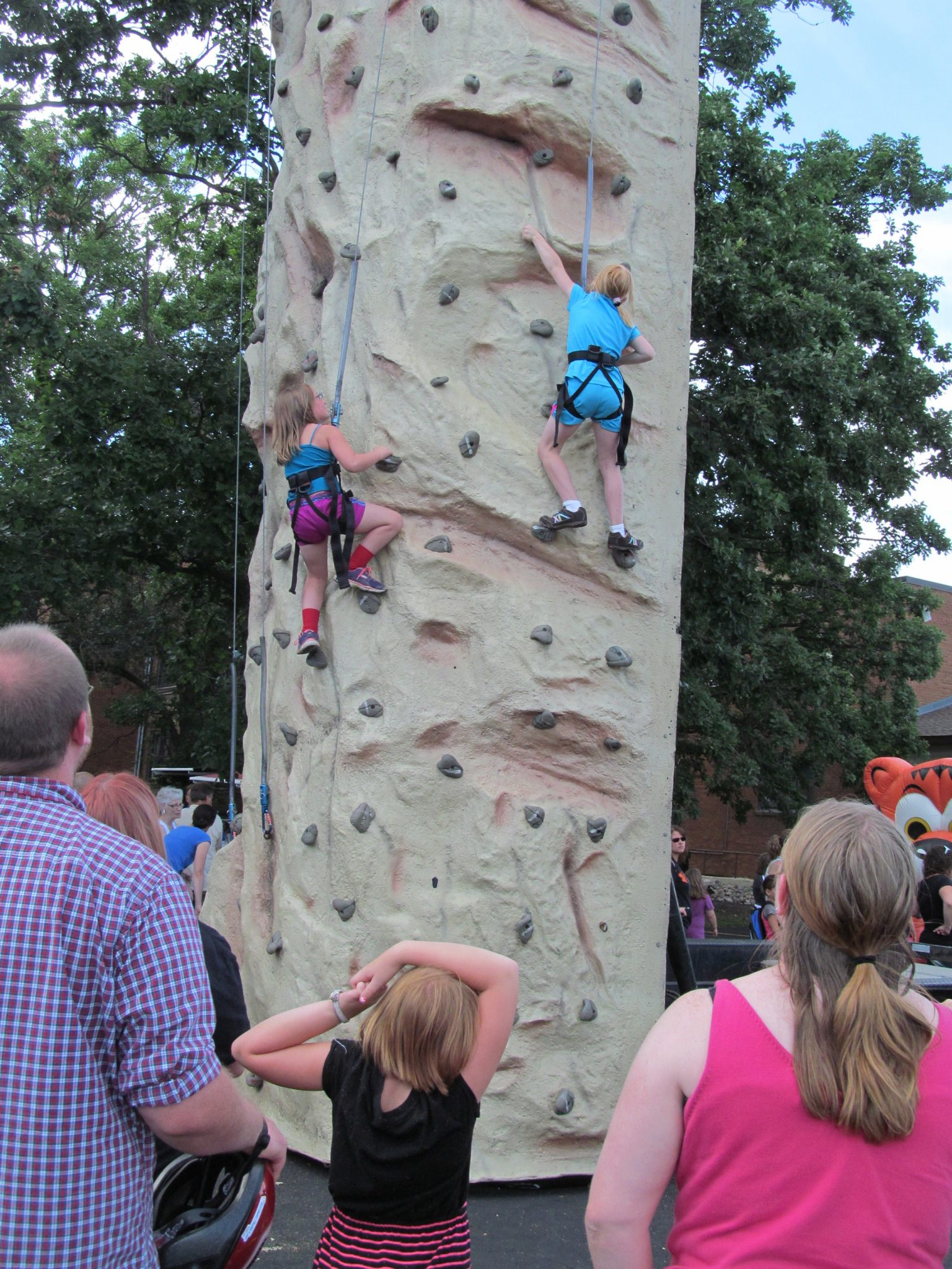 Kids climbing the rock wall at the Block Party.