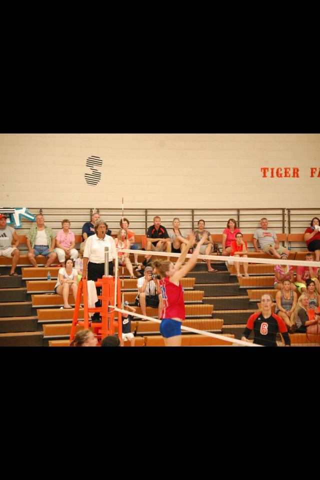 Taylor playing High School Volleyball.