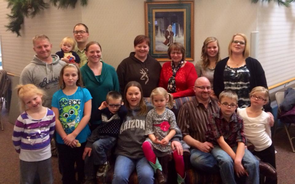 Pat Lorentz (in red) celebrates Christmas with her children and grandchildren.