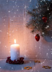 Fir branch, candle and  Christmas decorations