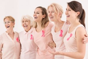Happy breast cancer survivors supporting each other