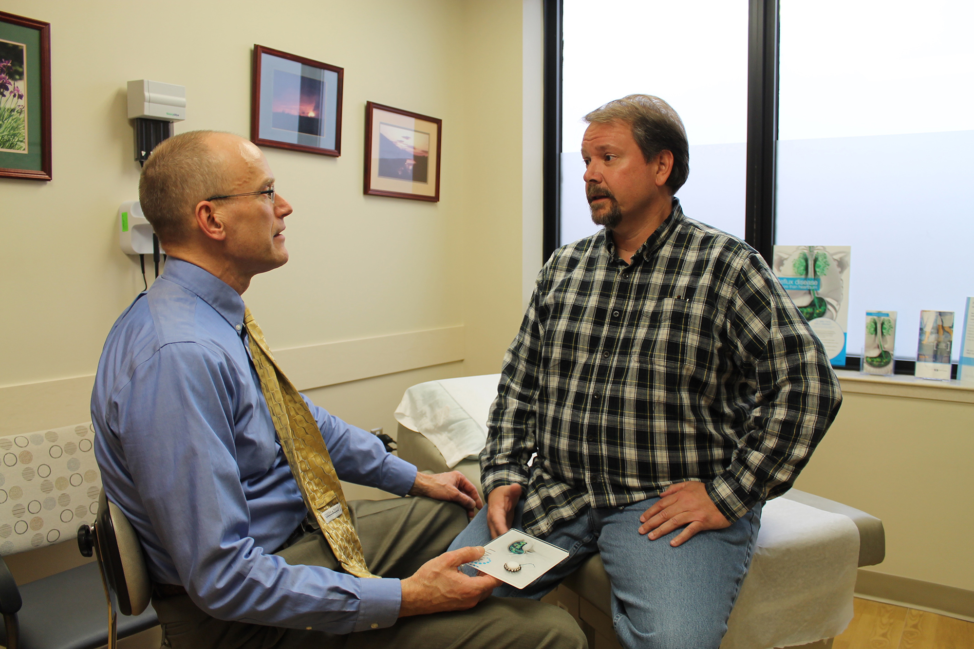 Dr. Kloss consulting with patient