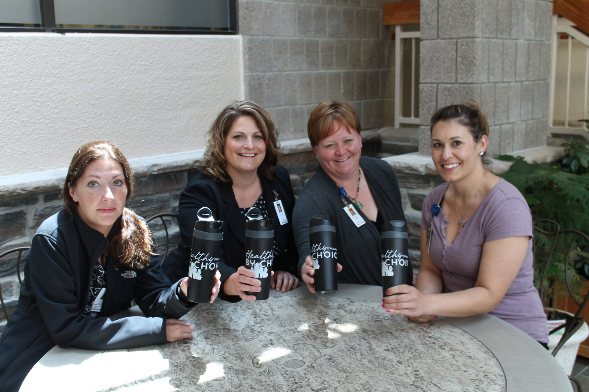TCHC employees enjoying their water in Healthy By Choice reusable water bottles.