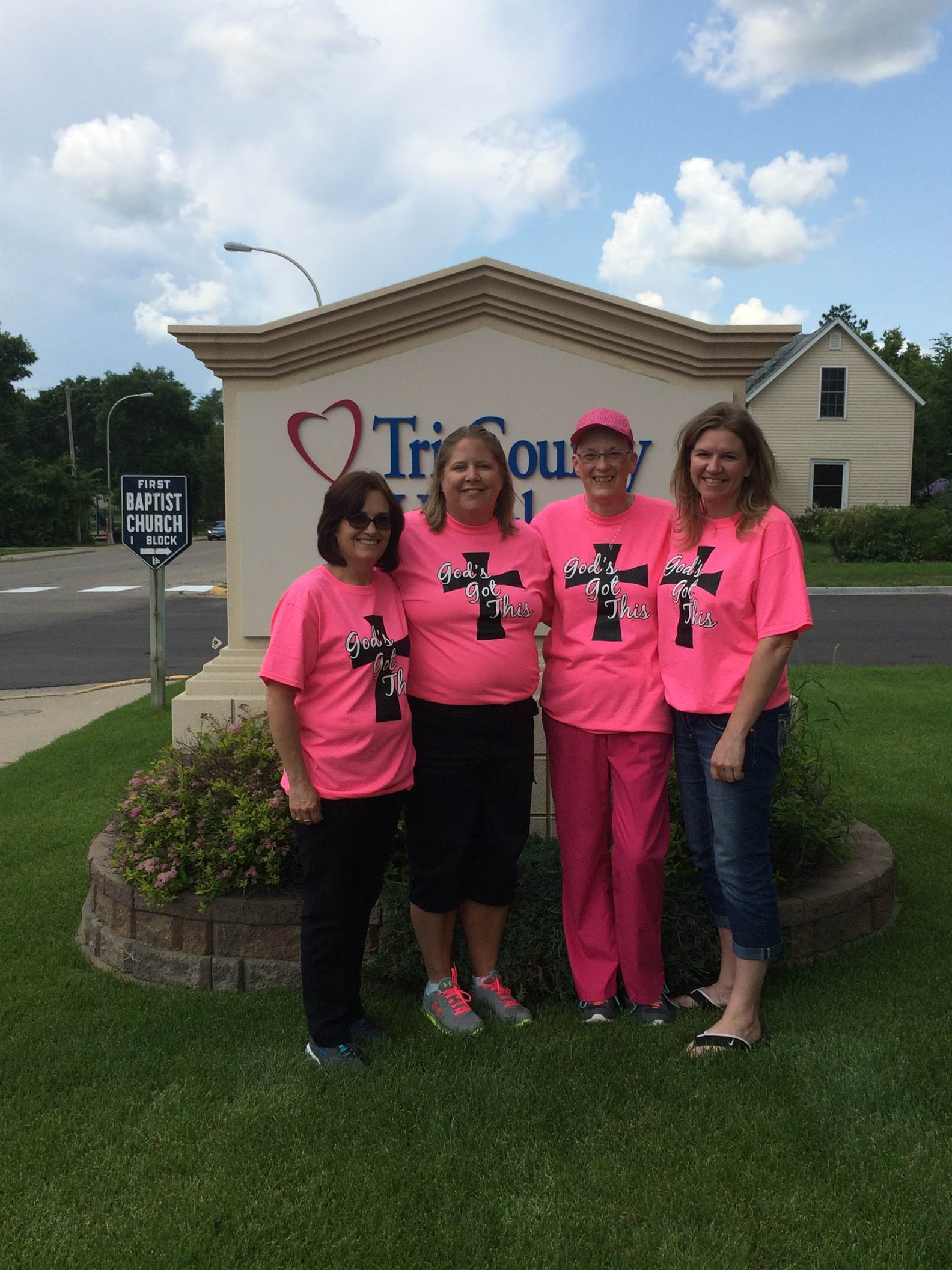 Deb with her co-workers wearing the t-shirts they had made for a fundraiser to help her offset her medical expenses.