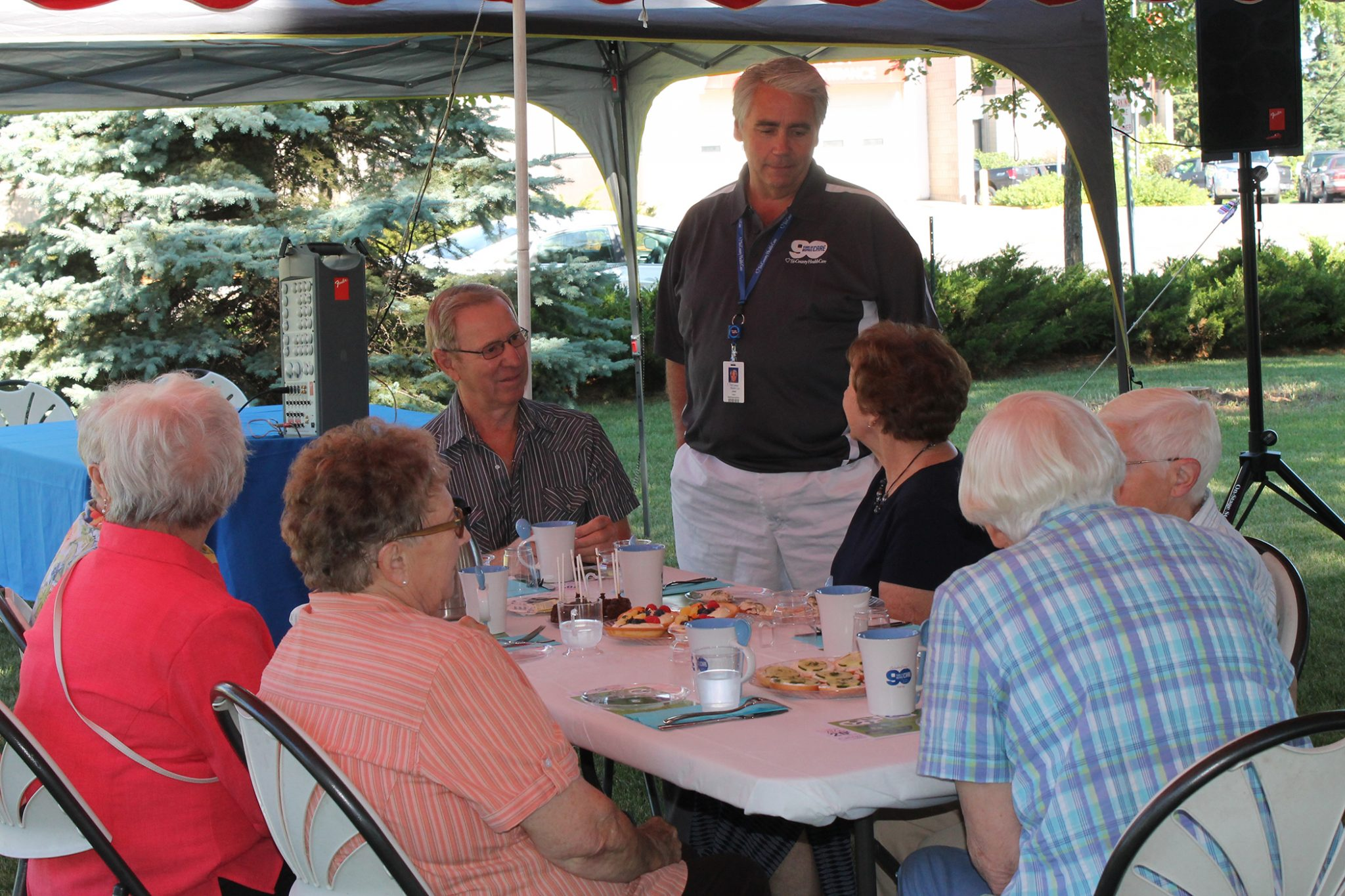 Joel Beiswenger, CEO/President of TCHC speaking with guests at the Retirement Tea.