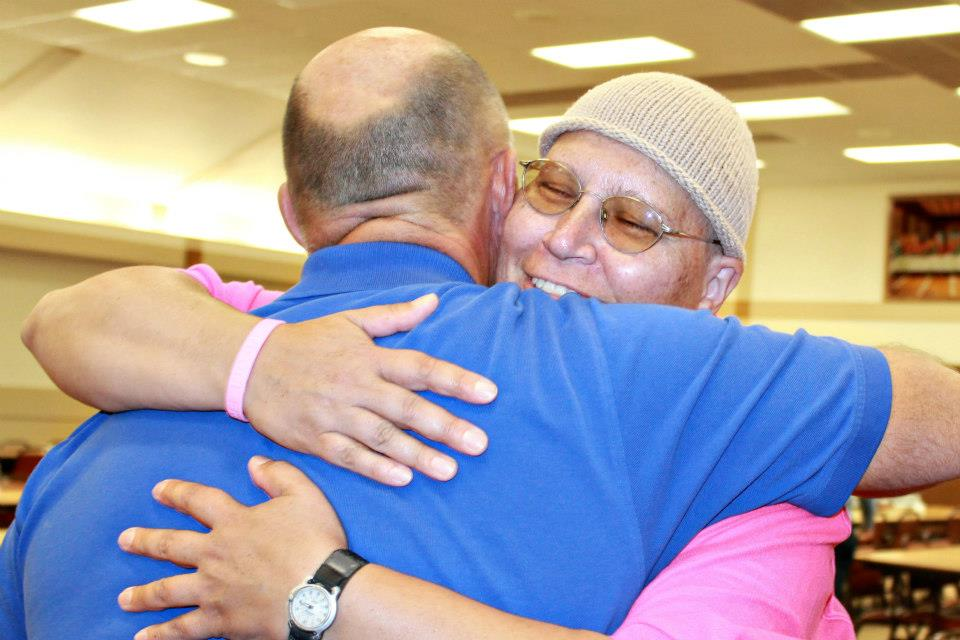 Sharon Heinen hugging at benefit