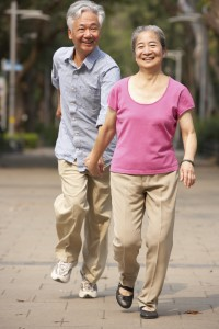 Senior Chinese Couple Walking In Park
