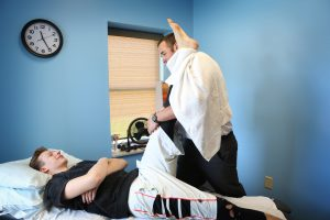Sprains and strains being treated by physical therapist.