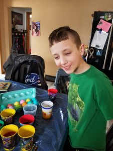 Jacob coloring Easter eggs.