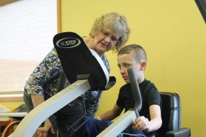 Photo of Jacob during his occupational therapy session with therapist, Lora Foust.