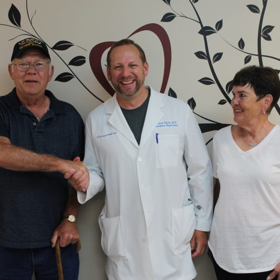 Stroke survivor, Teddy Jennings, shaking the doctor's hand who saved him.