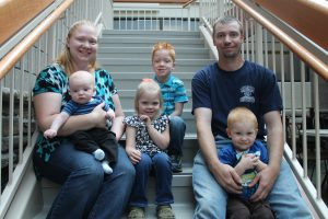 Brandon and Gretta Christiansen with there children, including Parker, who has a genetic disorder called PKU.