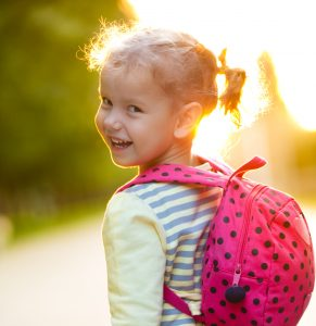 Smiling girl with backpack