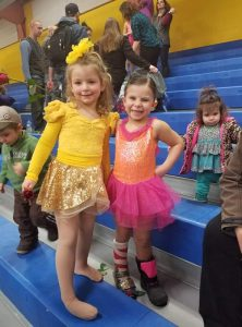Savhannah poses for a dance picture with a friend after her farm accident.
