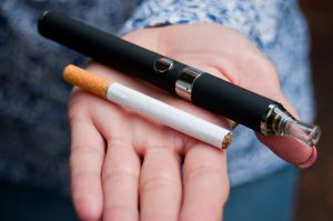 closeup of hand of woman with e-cigarette