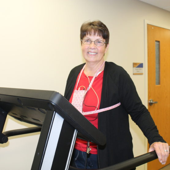 Carolyn Flicek walks on a treadmill to increase her heart strength after her heart attack.