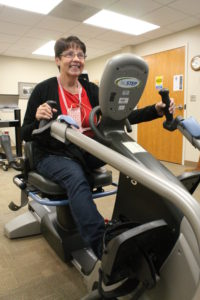 Carolyn Flicek rides a recumbent bike to gain heart strength after her heart attack.