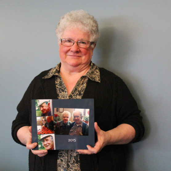 Karen Leverin holds a photo of her parents who she was the caregiver for before they both passed away from dementia.