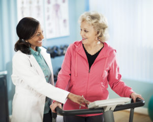Active senior woman exercising on treadmill during pulmonary rehab sessions