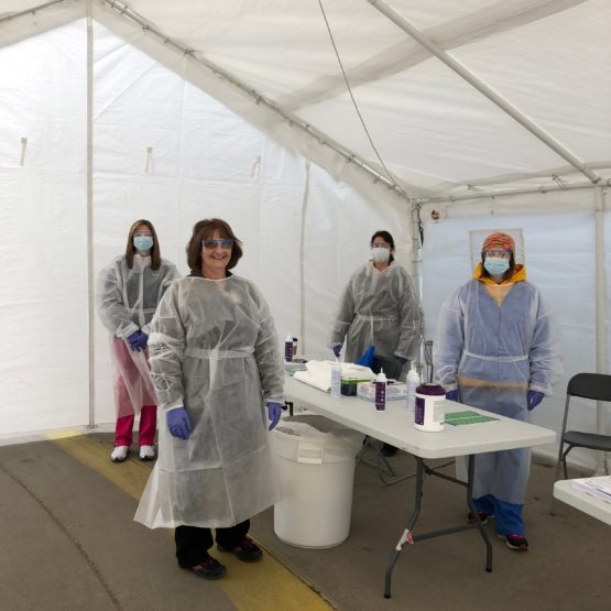 Staff in PPE set up in the coronavirus screening tent