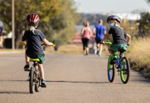 two children cycling in suburbs of Johannesburg amidst the Coronavirus lockdown