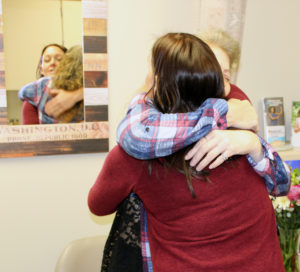 Addiction Relief: Laura DuChene, M.D., hugs patient for reaching 12 months of sobriety.