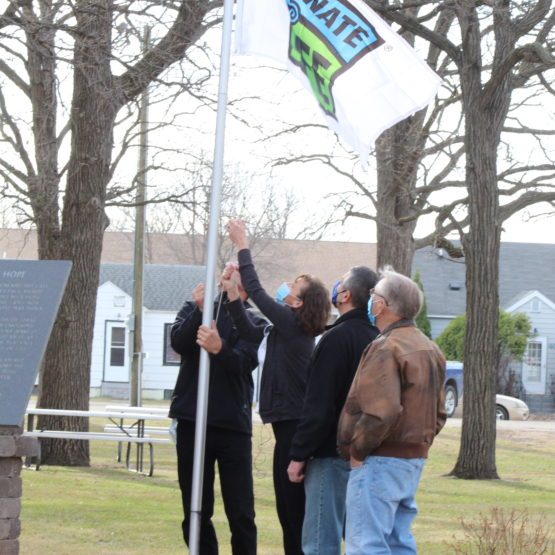 Sarah and her family were present to raise the Donate Life flag